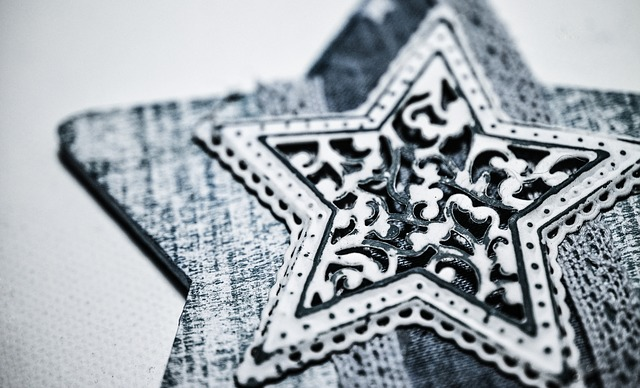 Rustic home decor white and black 5 pointed star on a white background.