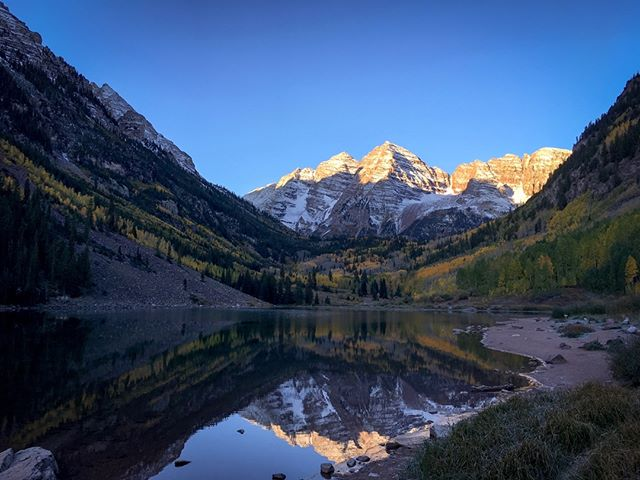 The Maroon Bells in Aspen, Colorado just a minute or two after sunup. As a small business owner, maybe you want more time to visit all of the iconic spots in Denver. Why not have your Social Media professionally managed by locals? . To learn how to grow your Instagram and get more customers, readers or followers, click the link in our bio🔝