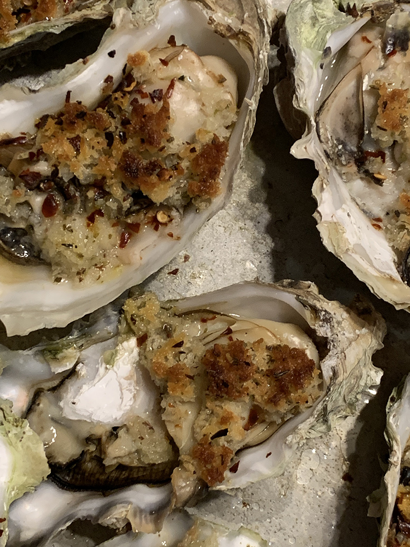 "Baked oysters"" panko crumgs, oregano, lemon zest, butter and crushed red pepper - variation on  Spruce Eats Recipe"