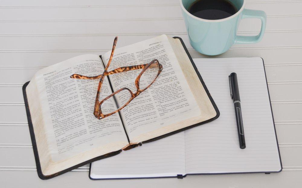 bible notebook pen and blue coffee mug on desk.jpg
