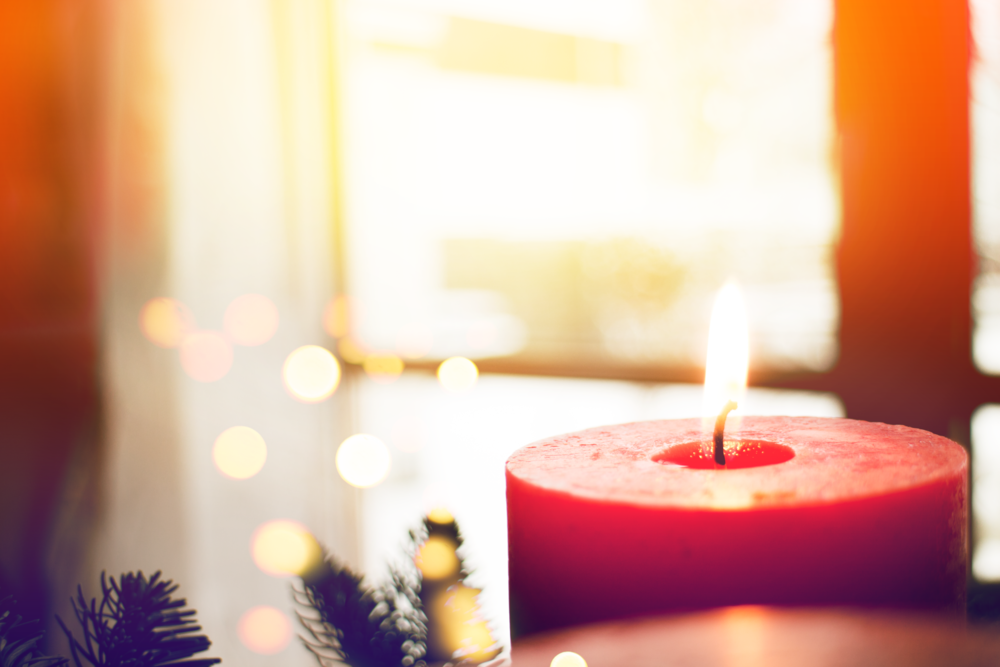 Inspiration for advent sermon themes from Backstory Preaching. Image of red advent candle.