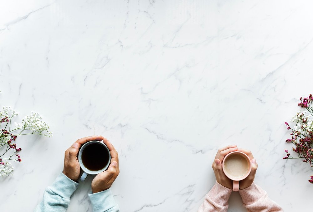 two people with hands around cups of coffee on marble table backstory preaching conversational preachin rawpixel-611117-unsplash.jpg