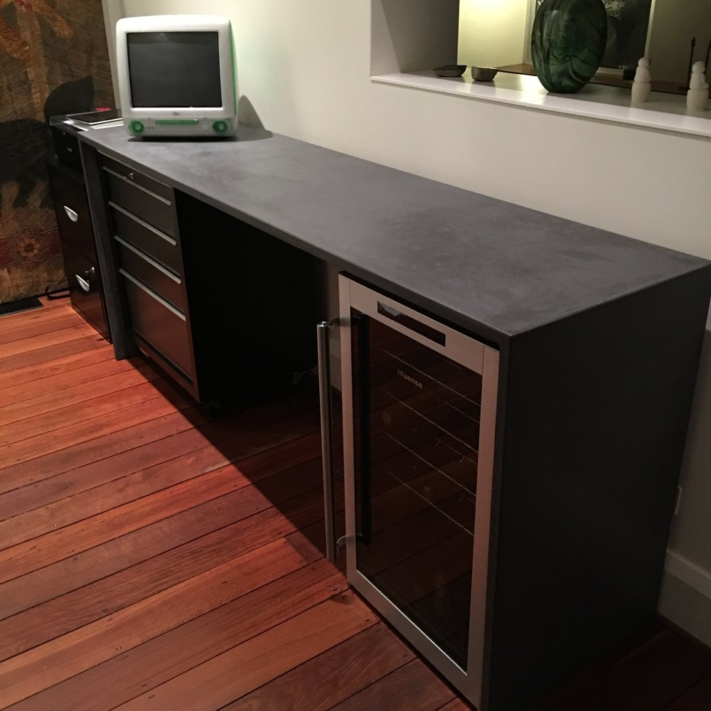 Black concrete desk with waterfall ends