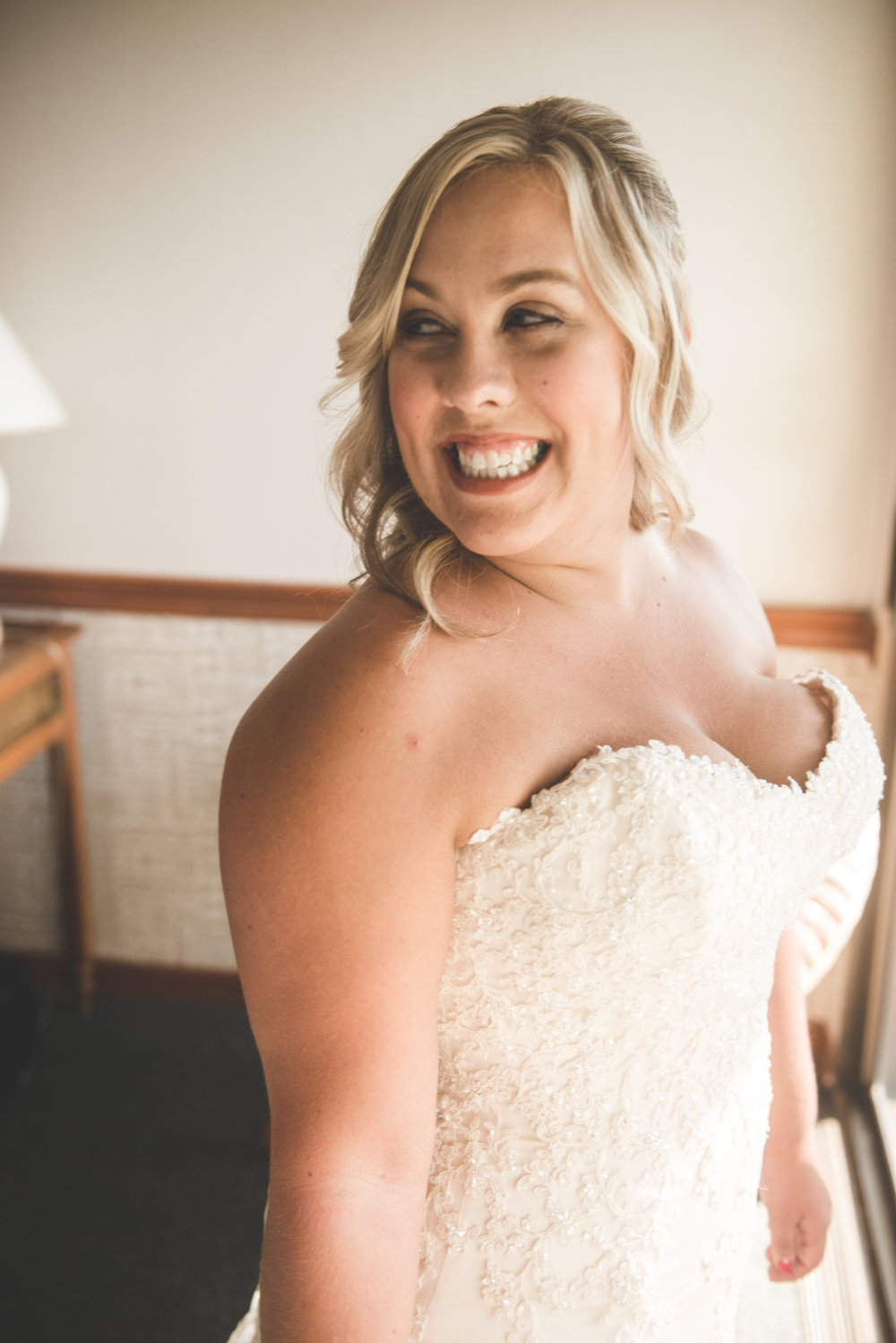 maui bride smiles as she gets ready