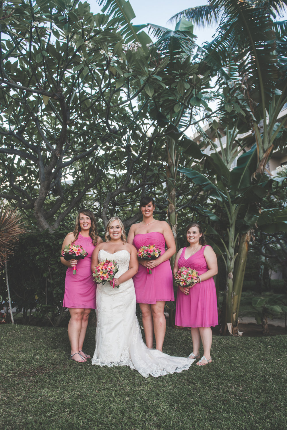 bride poses with bridesmaids in maui