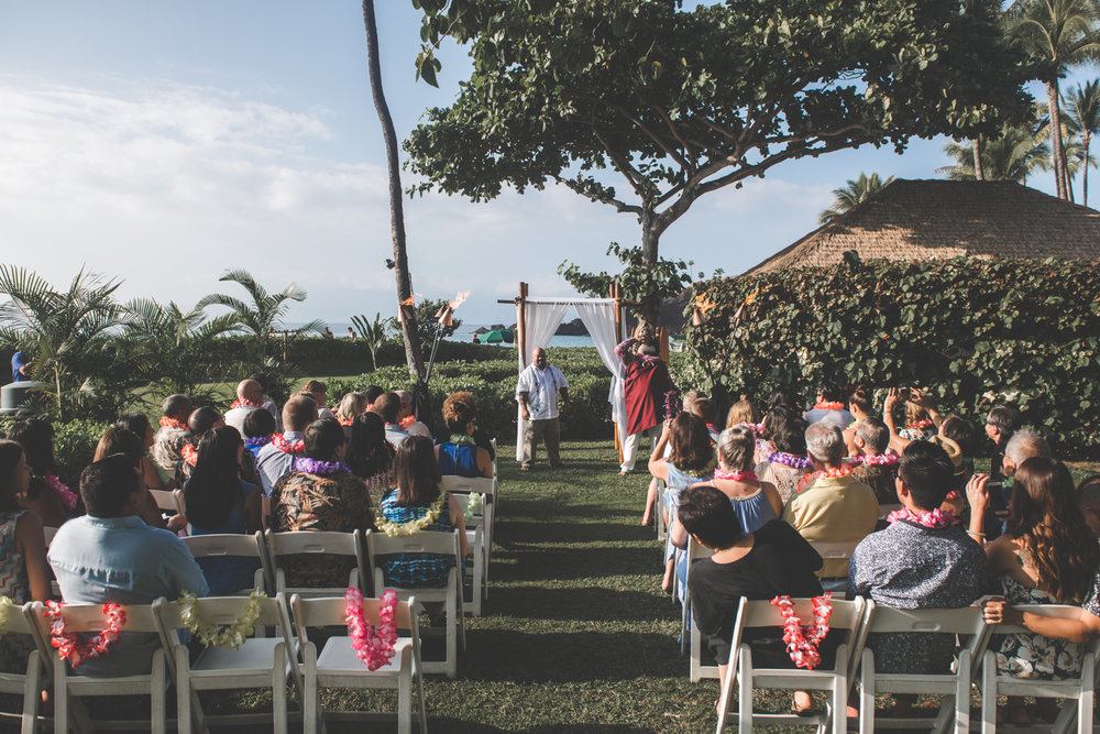 groom and guests wait for bride on Maui lawn