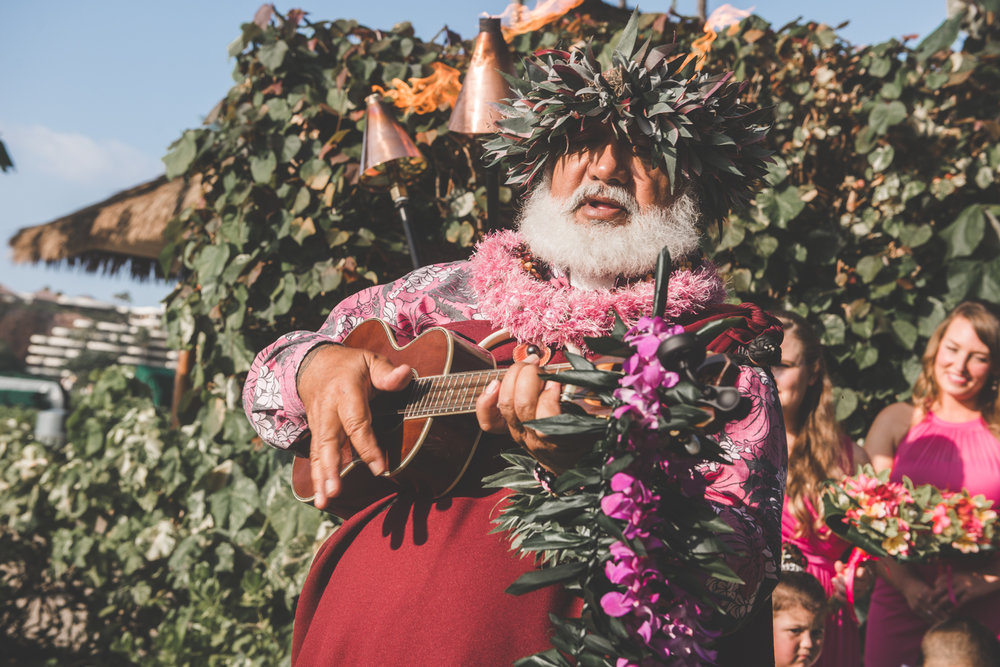 hawaiian wedding minister plays ukulele in maui