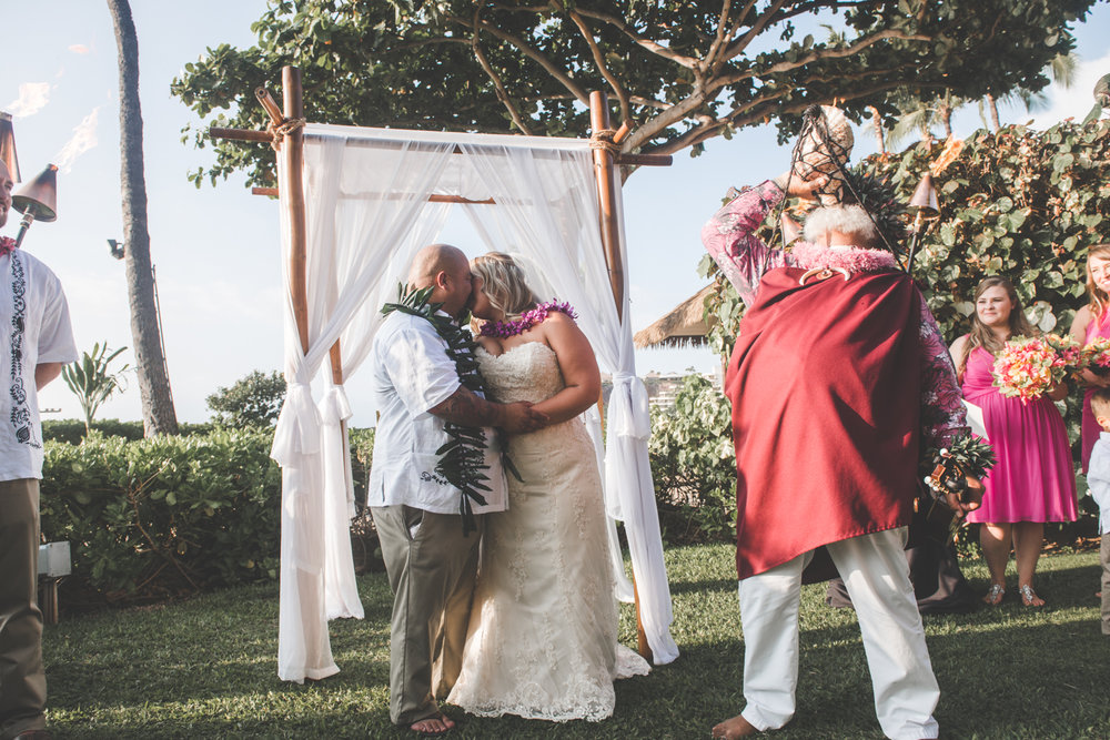 man and woman get married on Maui lawn