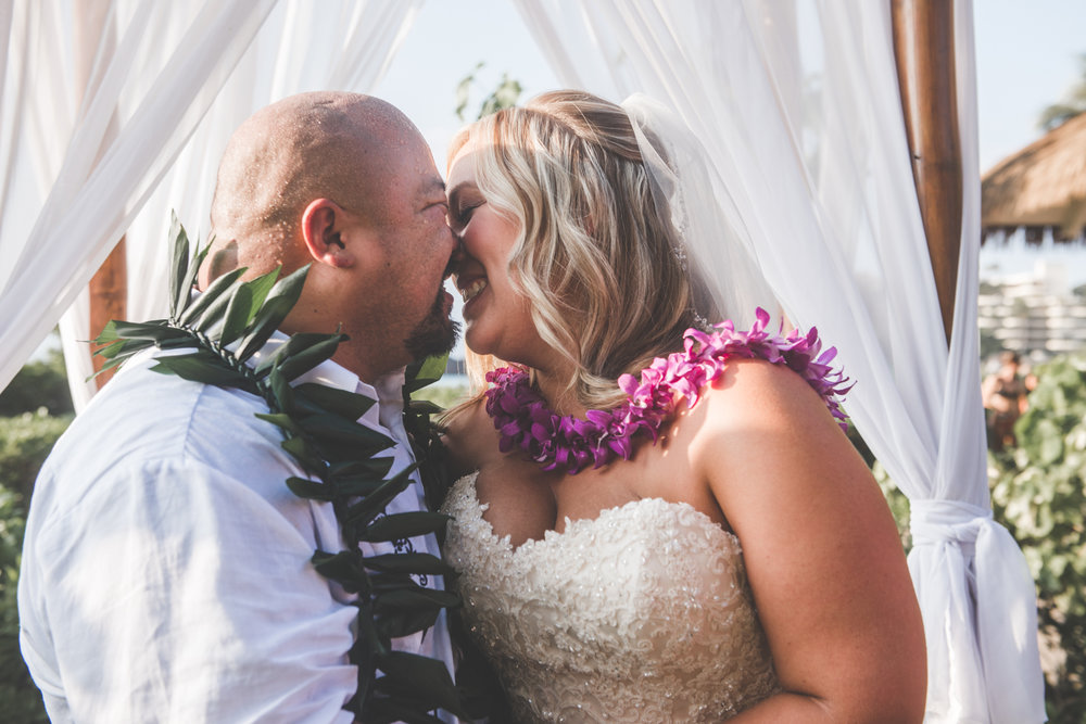 bride and groom kiss in maui wedding