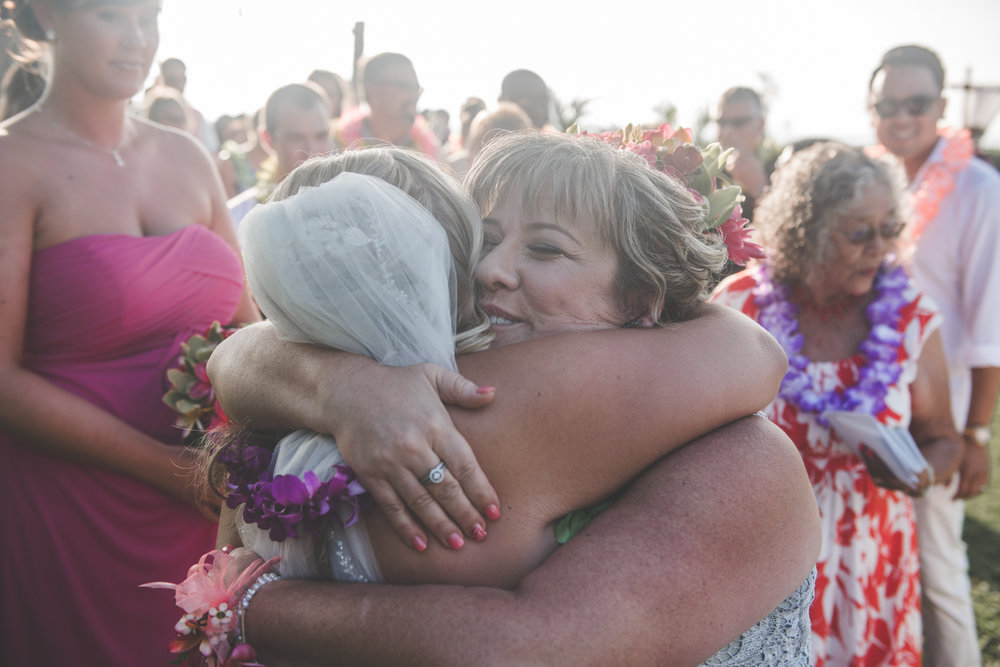 bride hugs mother after maui wedding ceremony