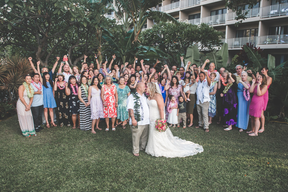 maui bride and groom pose with family and friends
