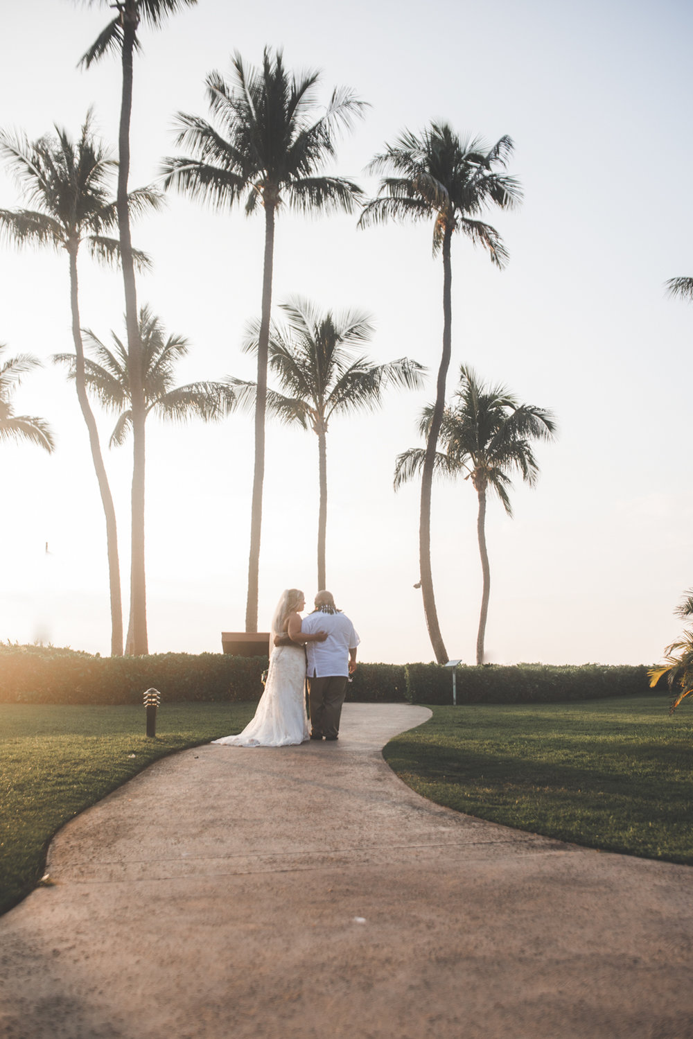 bride and groom and maui palm trees