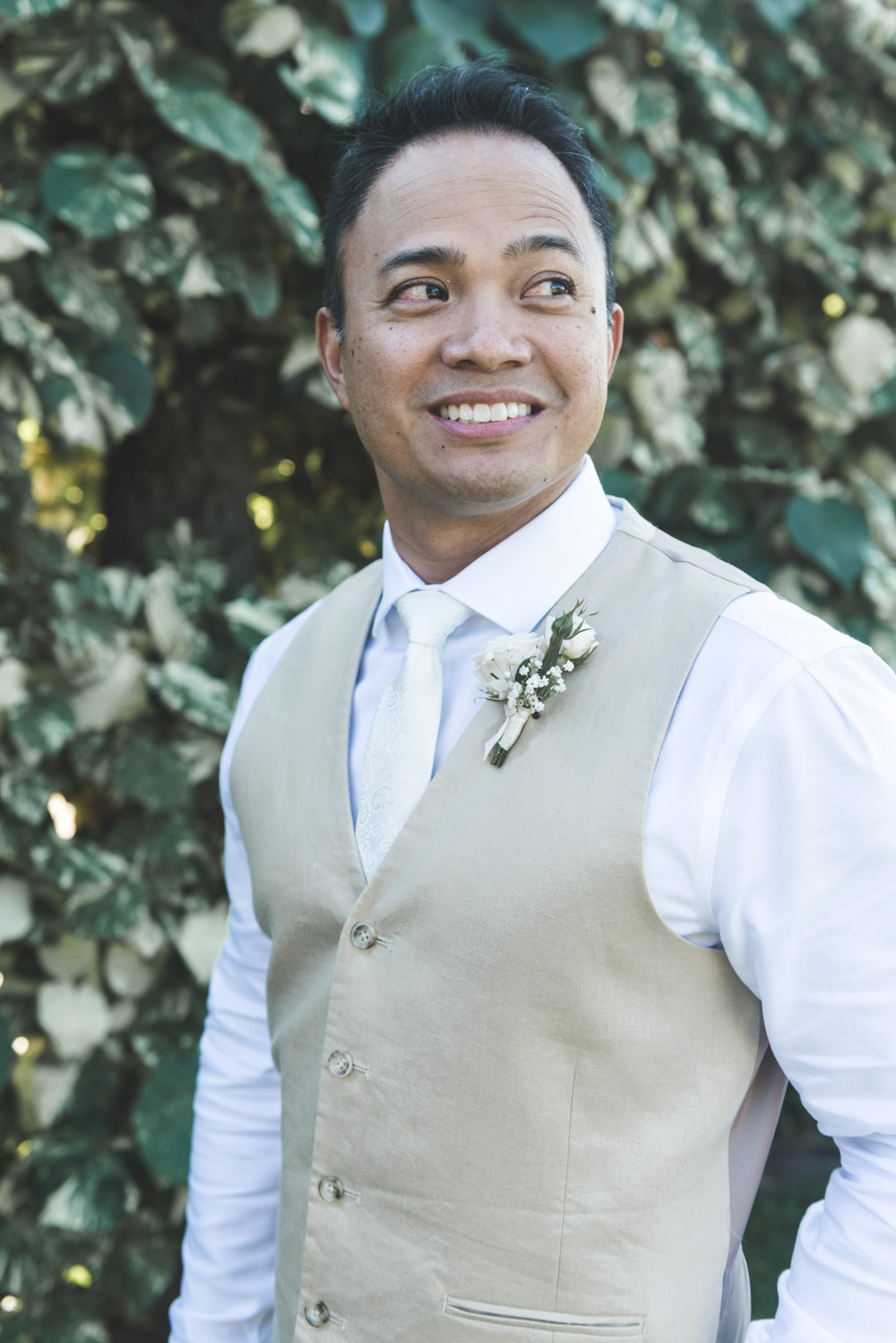Maui groom smiling before Maui wedding
