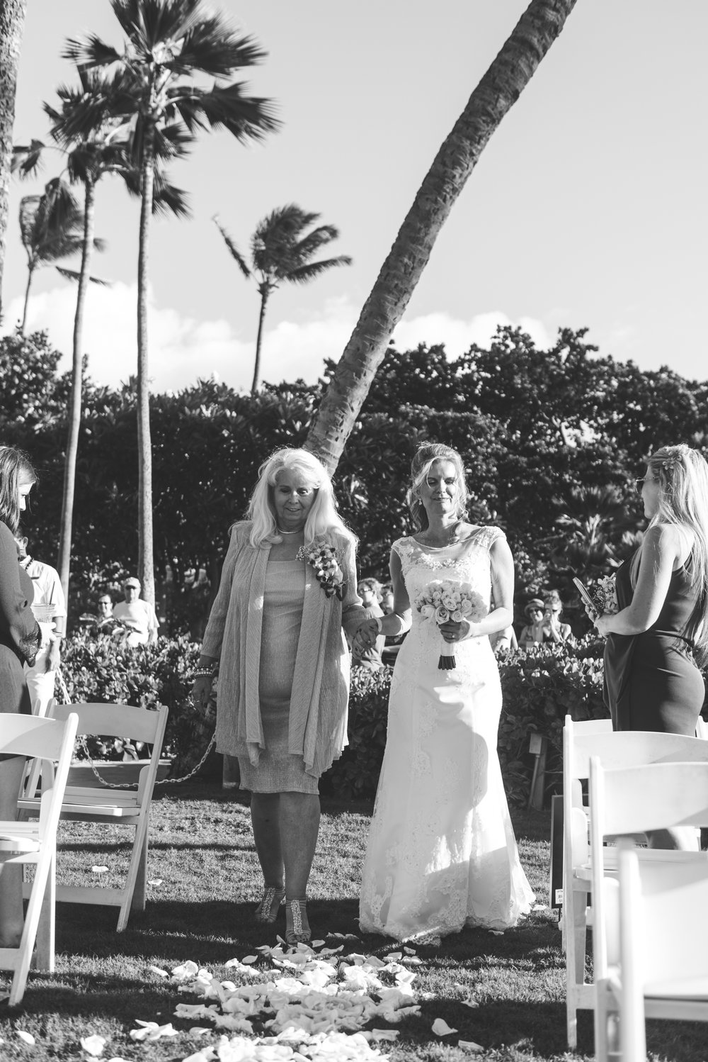 bride and her mom walk down the aisle maui wedding