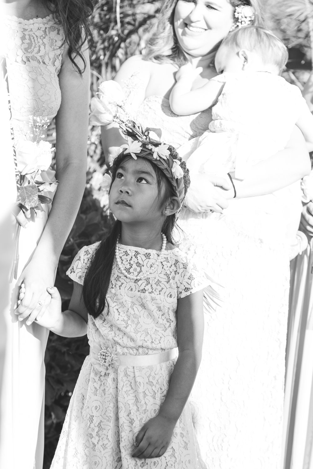 black and white image of flower girl in maui wedding