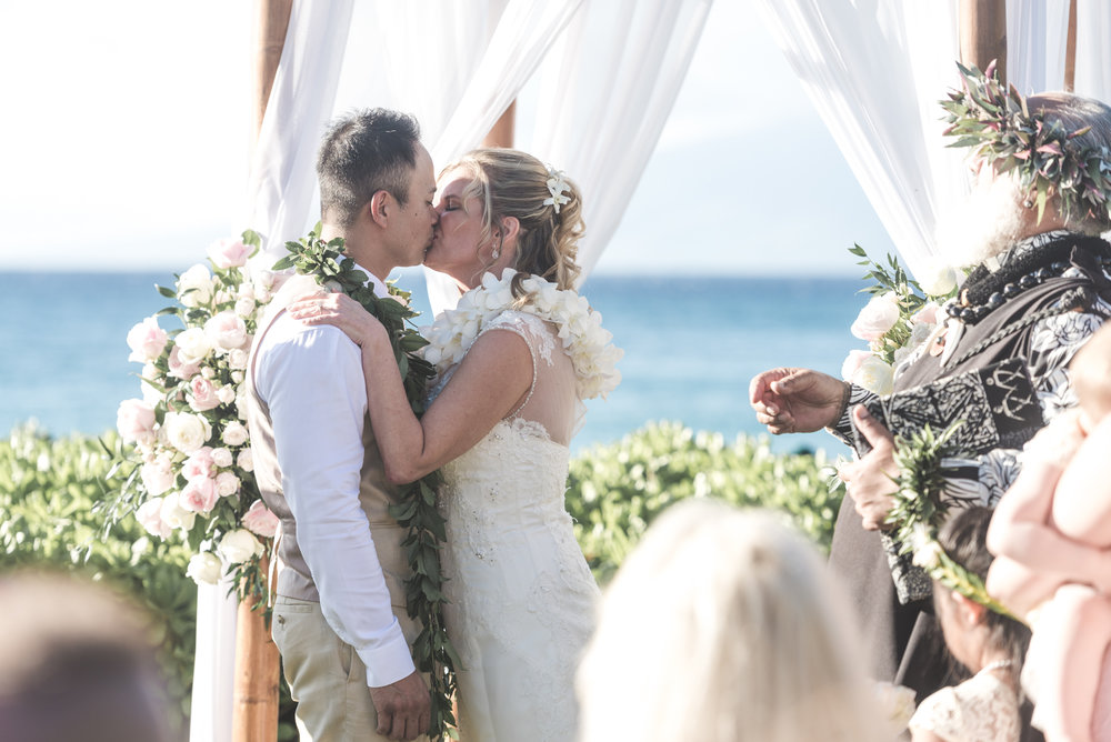 just married on maui, bride and groom kiss
