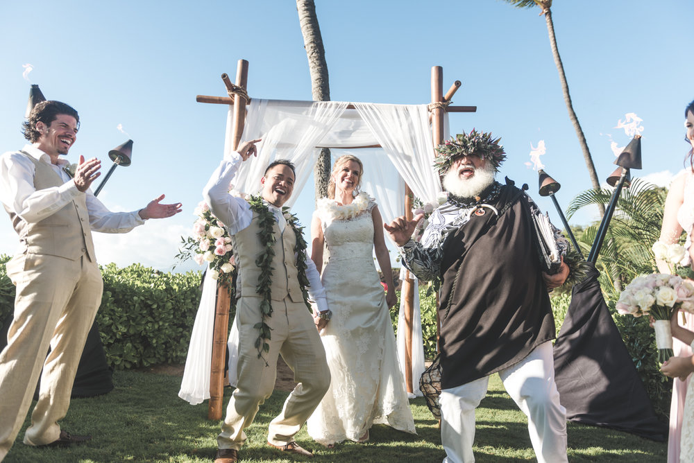 bride and groom and minister smile in maui wedding
