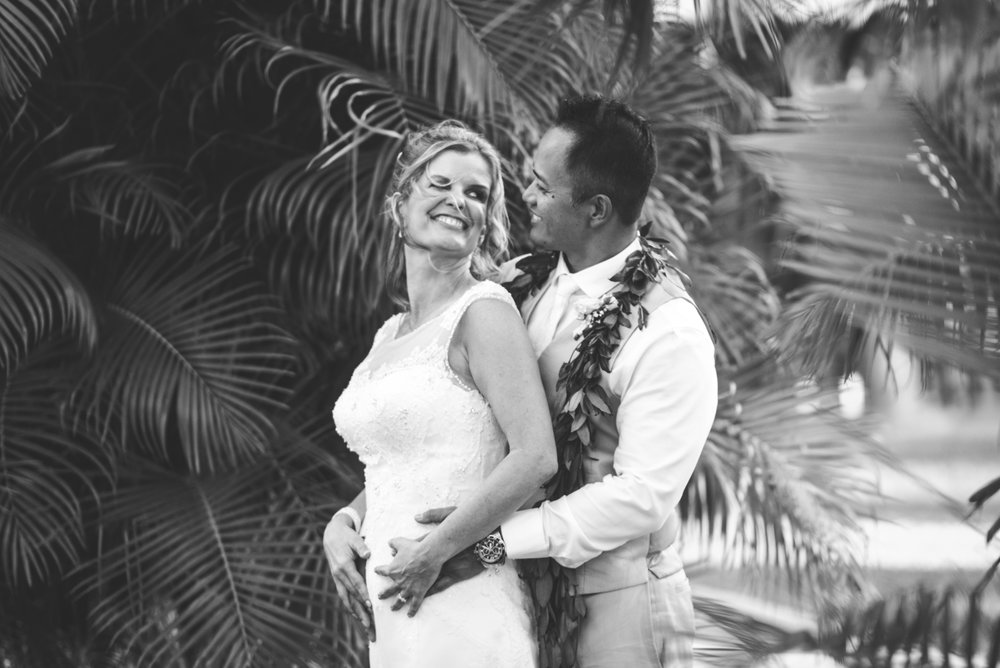 black and white tropical photograph of bride and groom in maui