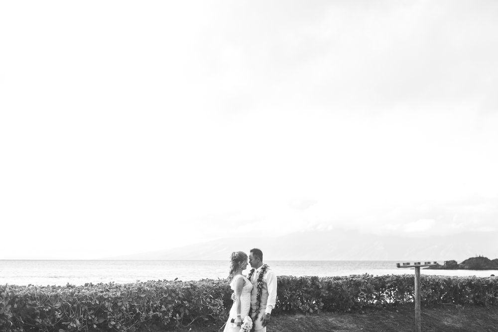 bride and groom gaze at each other after wedding ceremony in maui