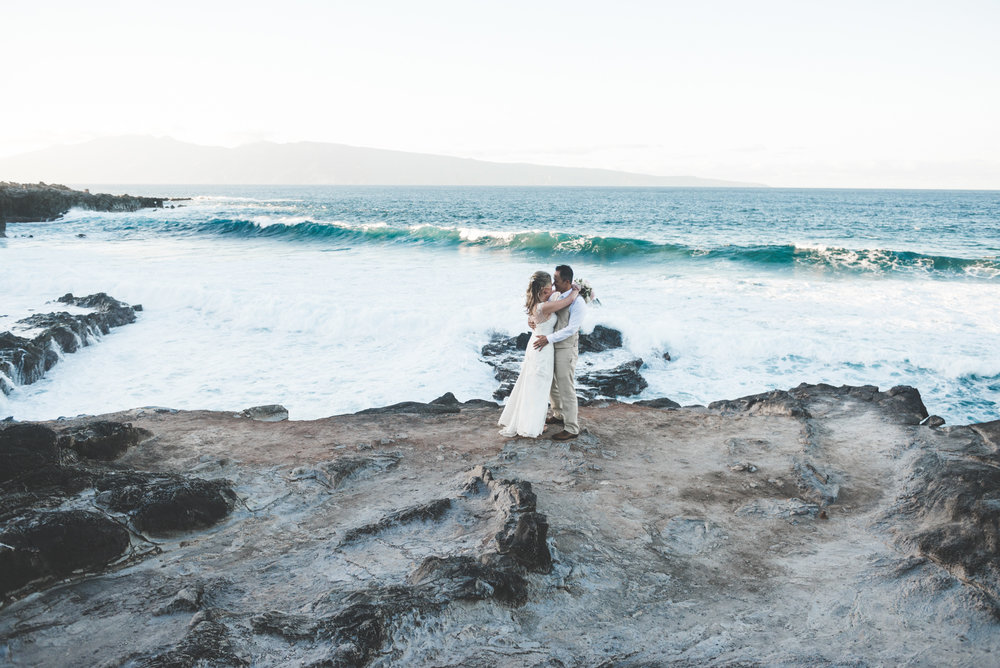 bride and groom embrace in maui wedding beach portrait