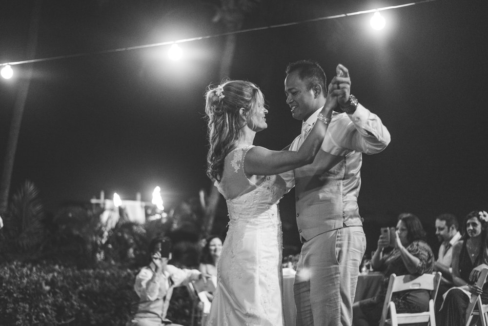 black and white shot of the maui newlyweds dancing