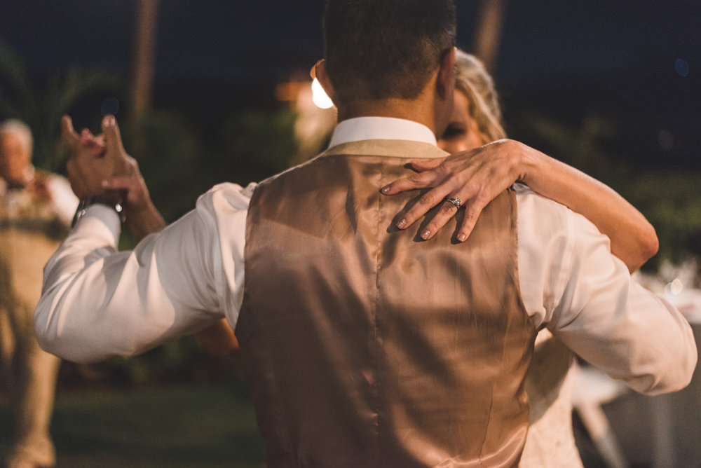 bride and groom dance at night in maui wedding
