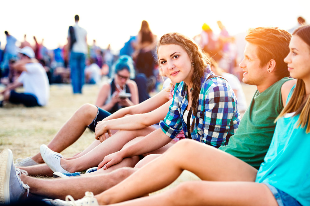 bigstock-Teenagers-at-summer-music-fest-121970183.jpg