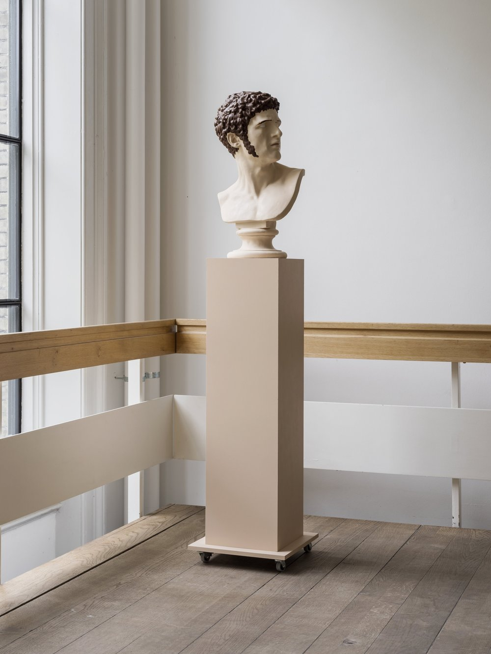 Installation view. The first bust out of three.