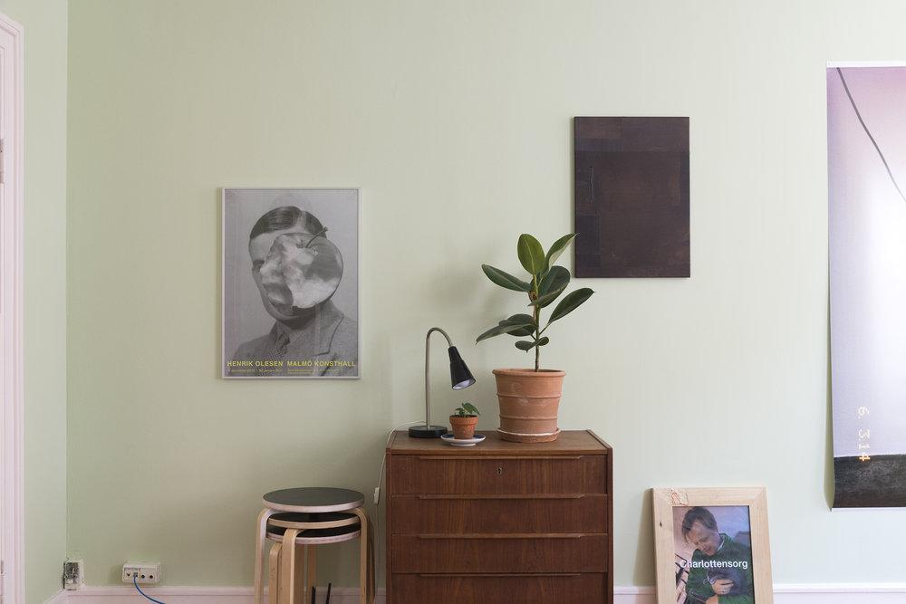 From the left: Poster från 2011, Henrik Olesen, Malmö Konsthall,                             MTWTFSS12WEEKDAY (2102-2014), artist's pant on stretcher (back), Moa Alskog,                               Charlottensorg (2016), inkjet print on paper, wooden frame, Sara Ursina