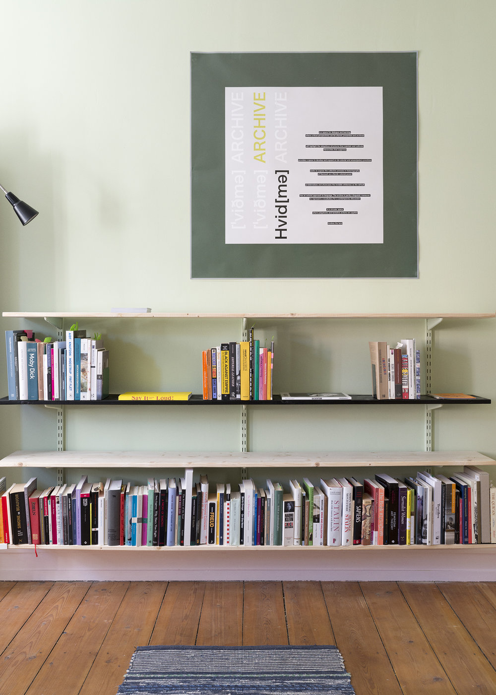 Hvid[mə] Archive (Annarosa Krøyer Holm and Miriam Haile)-Library on critical whiteness study and decolonial perspectives Poster: Manifesto,Postkort A5 :[ˈviðmə]                                                     On floor: Kvist Trasmatta (Kvist Rag Rug), (2016), Helen Alskog