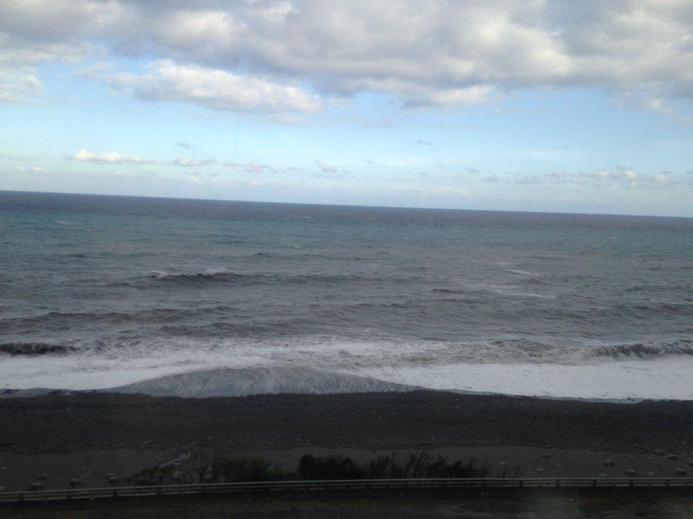 Check out that black sand beach!