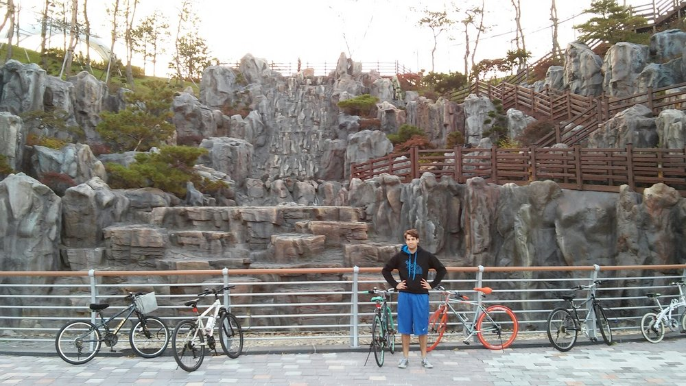 Matt posing ever so elegantly with our bikes at a park in Sejong