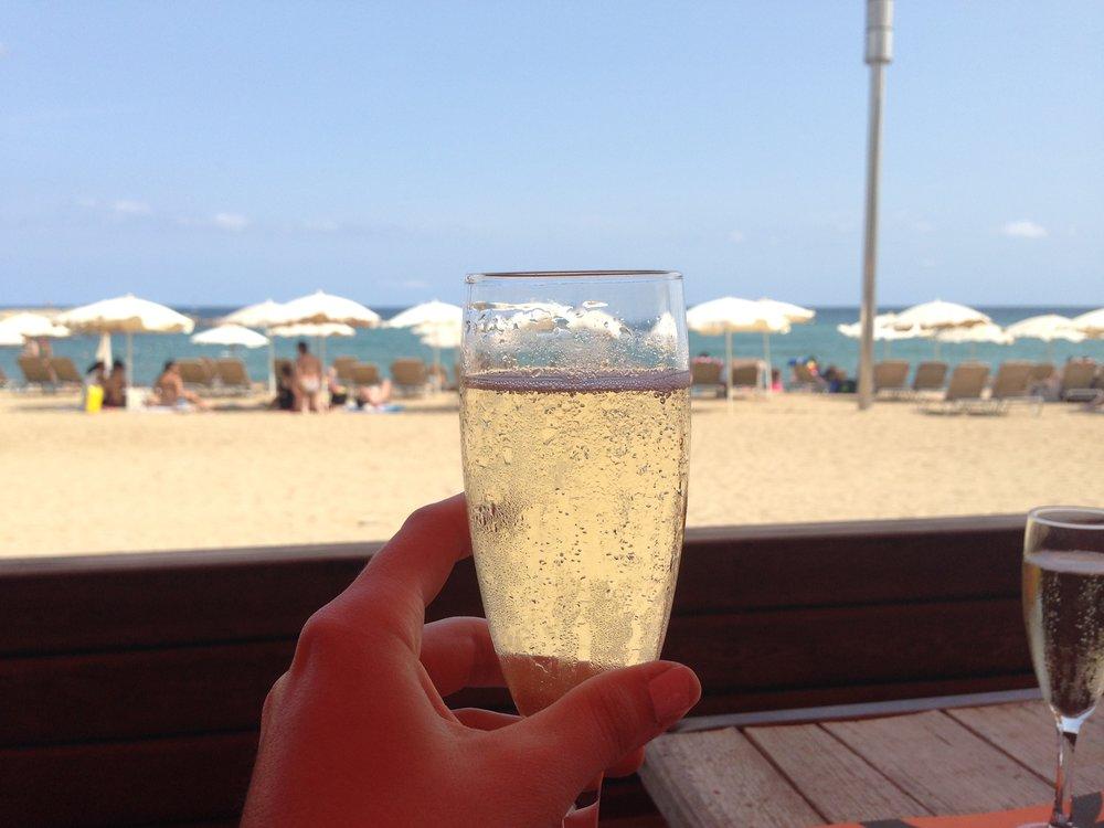 A glass of Cava, Calatonian sparkling wine, on La Barceloneta