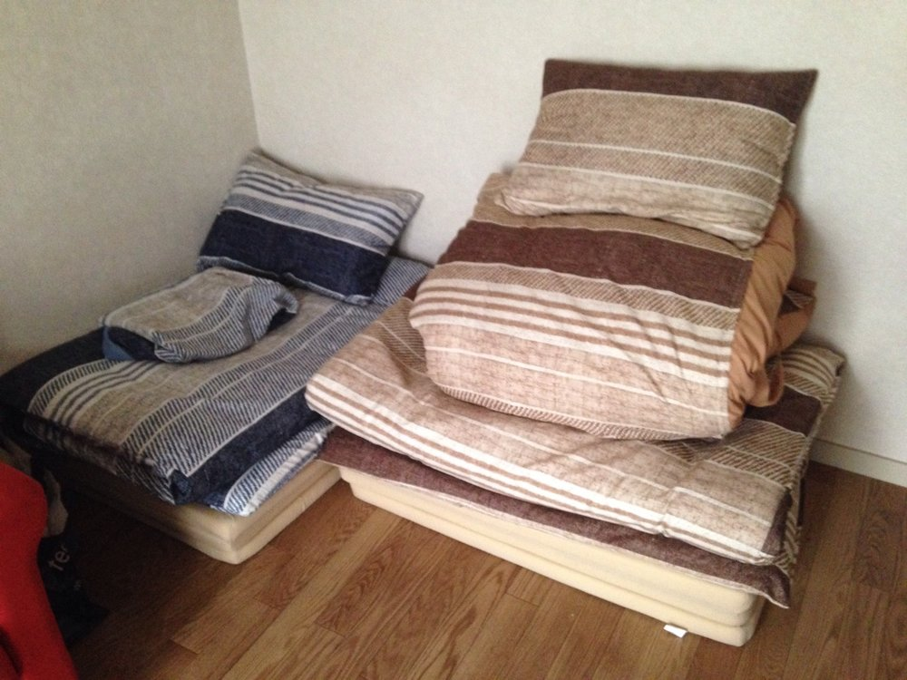 Our beds, folded up neatly in the corner of our bedroom/living room
