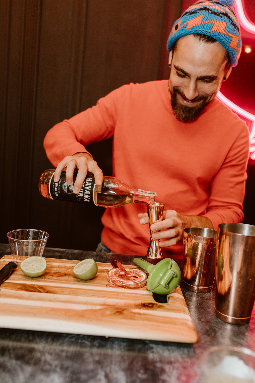 Gio Gutierrez of Havana Club Rum shakes up drinks at the chicken bar | drinkingwithchickens.com