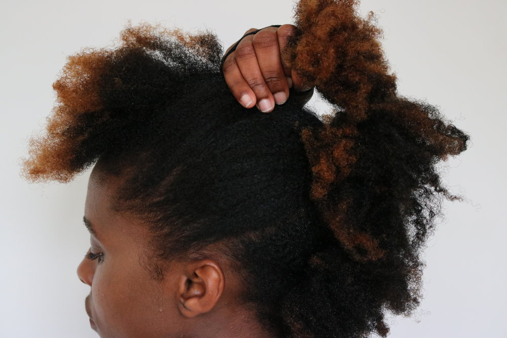 Part front section and secure it with a hair tie