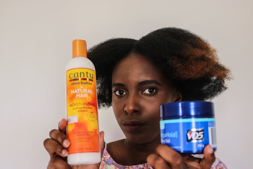 As we usually do, start with stretch hair. I'll be using Cantu Shea Moisturizing Curl Activator Cream to moisturise and Vo5 gel to smooth my edges.