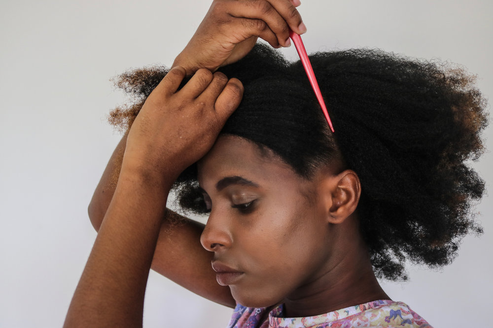 Using a rat-tail comb, part your hair into two - top half and bottom half