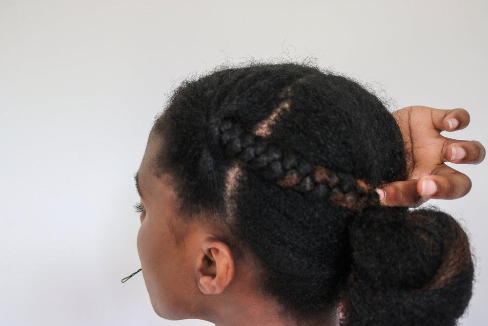 Pin down both braids close to the bun