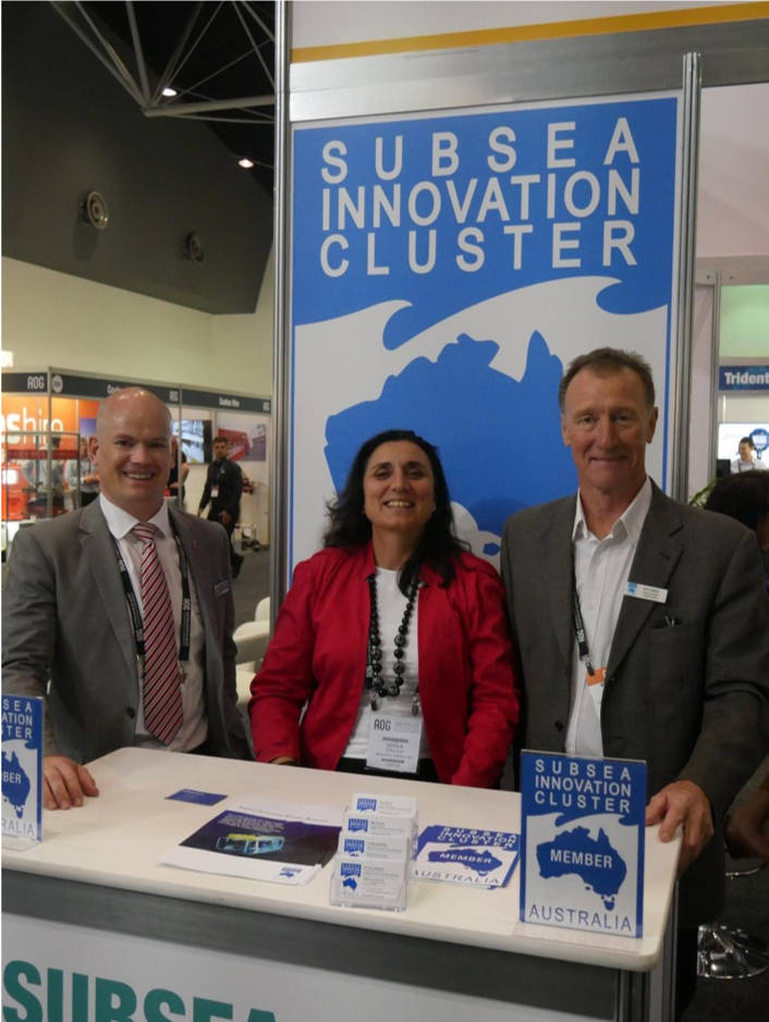 Marius Martens, representing Intecsea (SICA member), Voula Terzoudi representing Woodside (SICA member) and Ray Farrier Cluster Manager at the Subsea Innovation Cluster booth part of the Australia Subsea Pavilion.