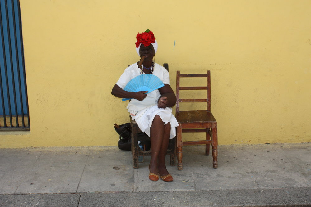 Cigar smoking Santeria woman in Old Havana