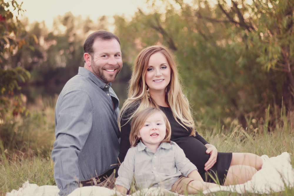 Fall Family Maternity Session In Field With Father Mother And Toddler Son Blue Shirts