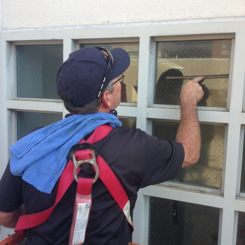 Sky Clean | squeegee window cleaning.jpg