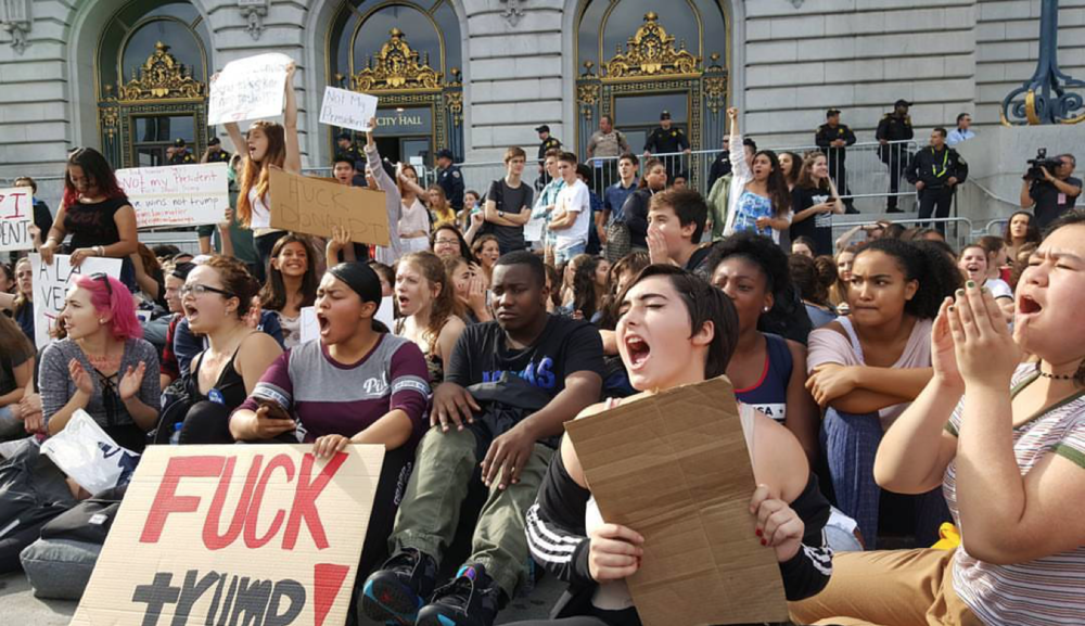 Teens portest Trumps inauguration at San Francisco City Hall.