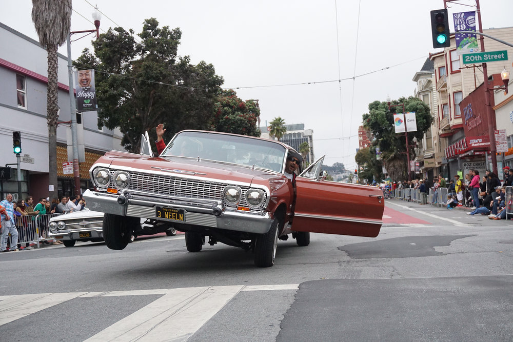 Low Riders show off during the Mission District's Carnaval Parade.
