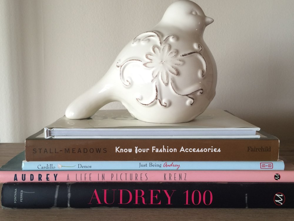 One of my many little glass birds sitting atop of some Audrey books.  There is also a book by one of my college professors.