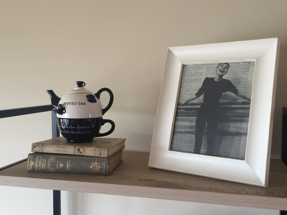 My mom gave me this tea pot from Teavana for my 21st birthday.  These vintage books were my great grandma's.  The Audrey print I purchased from River City Trading Post in Jenks, OK.  I found a lot of similar prints  here.