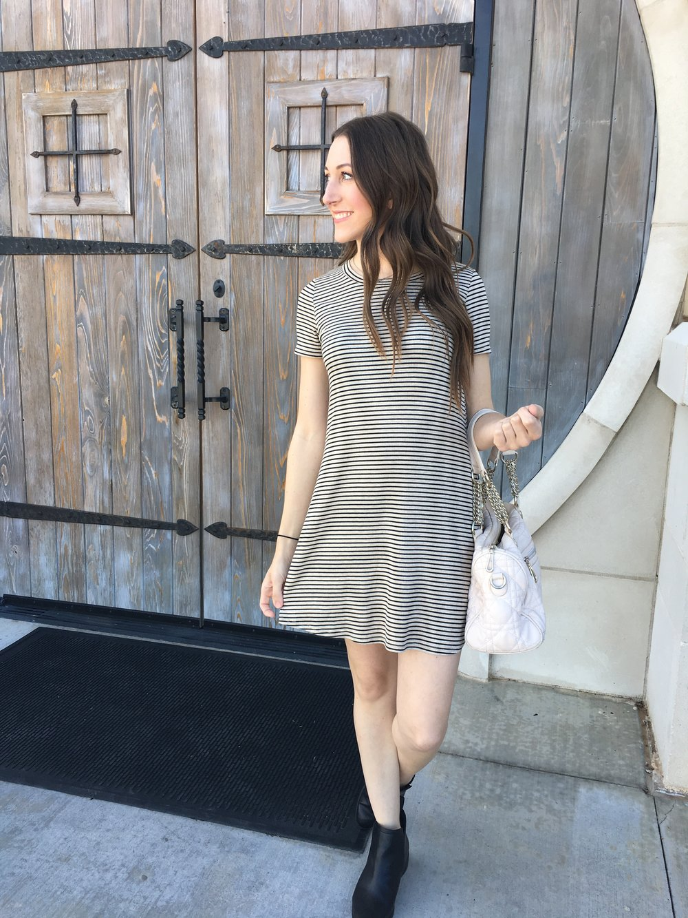 This dress is currently available in-store at Blu Spero, but I could not find it online.  The brand is Blu Pepper.  I tracked down a couple similar dresses  here  and  here .  My boots are from  Target  and my bag is from Francesca's and is no longer available.