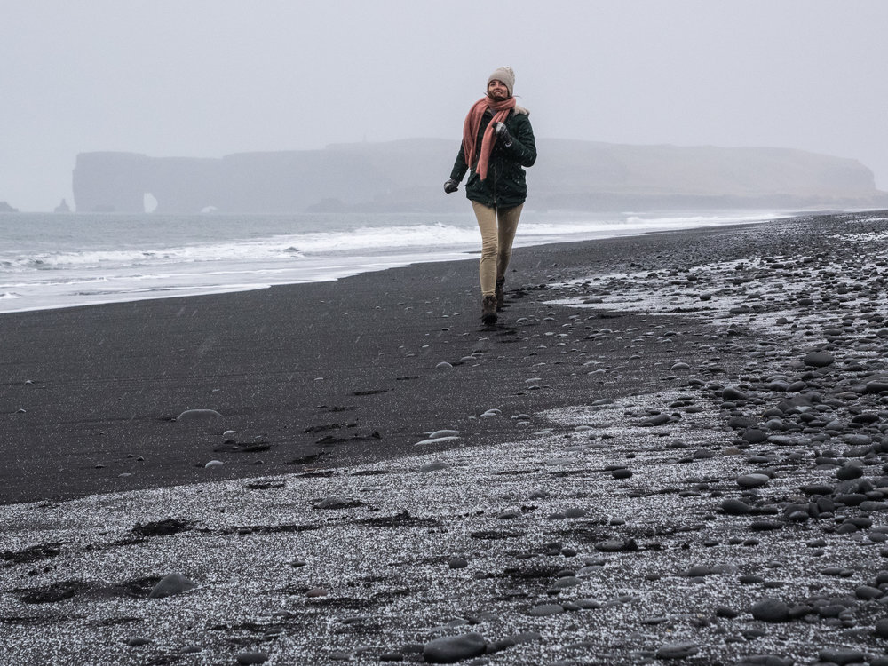 Snow turning Black Beach into White Beach