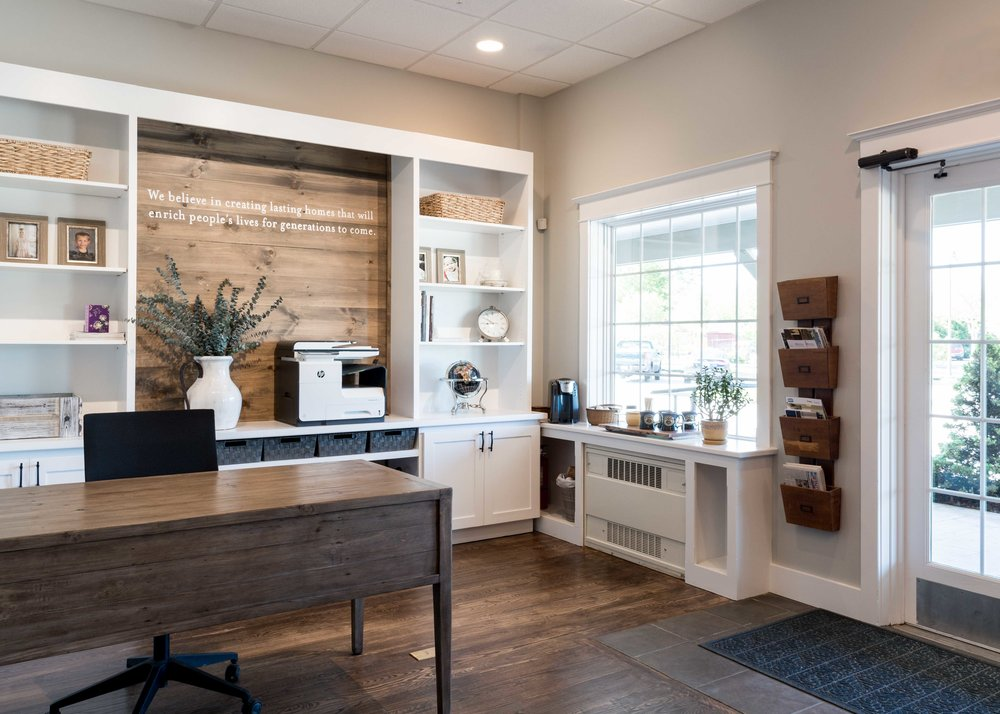 Our mission statement is written above the printer over the shiplap detail.